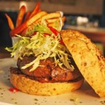 Catching the eye-watering Inferno Burger at Qube Sports Bar, Meydan Golf Course