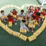 Nursery children prepare custom-made educational packs for the underprivileged