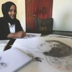 Fatima Farah with her artwork